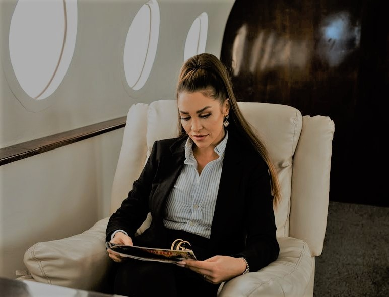 lady sitting on private jet